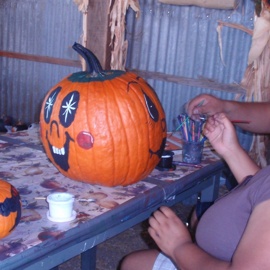 People painting pumpkin